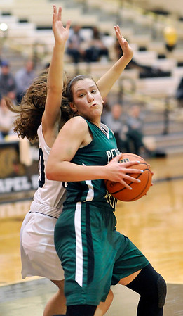 John P. Cleary |  The Herald Bulletin<br /> Lapel's Tylor Wyant tries to block Pendleton's Adrienne Phillips as she spins toward the basket for a shot.