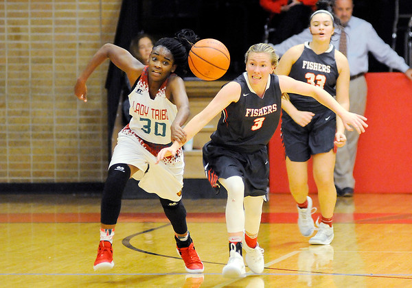 Don Knight | The Herald Bulletin<br /> Anderson's Tyra Ford and Fishers' Katie Burton scramble for a loose ball on Wednesday.