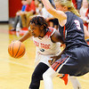 Don Knight | The Herald Bulletin<br /> Anderson's Staisha Hamilton drives as she is guarded by Fishers' Katie Burton on Wednesday.