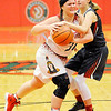 Don Knight | The Herald Bulletin<br /> Fishers' Skylar Fulton fouls Anderson's Kiersten Widup while reaching for the ball as the Indians hosted the Tigers on Wednesday.