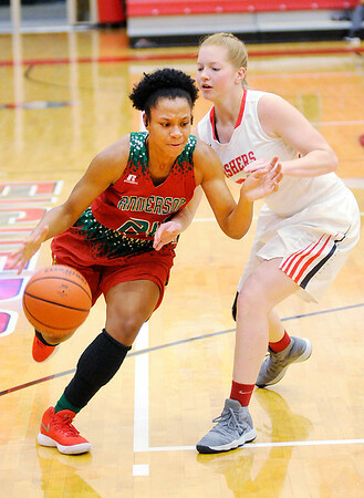 Don Knight |  The Herald Bulletin<br /> Anderson's Alandis Hill drives toward the basket as she is guarded by Fishers Casey Walker on Wednesday.