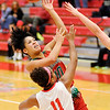 Don Knight |  The Herald Bulletin<br /> Anderson's Erin Martin shoots over Fishers' Toni Grace on Wednesday.