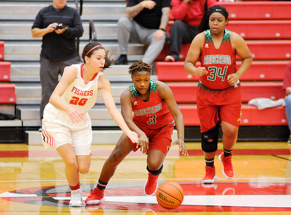 Don Knight |  The Herald Bulletin<br /> Anderson's Staisha Hamilton brings the ball down court as Fishers' Ali Gerka tries to grab the ball on Wednesday.