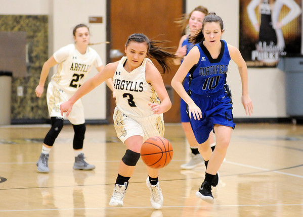 Don Knight |  The Herald Bulletin<br /> Madison-Grant's Maddi Evans runs after the ball after forcing a turnover as the Argylls hosted Northfield on Thursday.