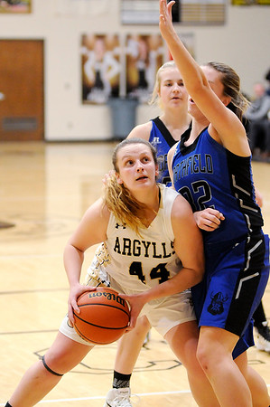 Don Knight |  The Herald Bulletin<br /> Madison-Grant's McKenna Lugar looks to shoot as she is defended by Northfield's Melanie Beery on Thursday.