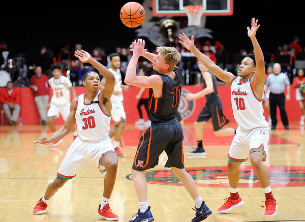 Don Knight | The Herald Bulletin<br /> Anderson's Tyquez Priester (30) tips the ball away from Harrison's Camden Smith as Priester and Joseph Jones double team Smith.