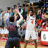 Don Knight | The Herald Bulletin<br /> Anderson's James Glazebrooks releases a three-point shot as the Indians  hosted the Harrison Raiders on Friday.