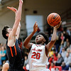 Don Knight | The Herald Bulletin<br /> Anderson's Tyrelle Wills shoots as he is guarded Harrison's Jordan Walters on Friday.
