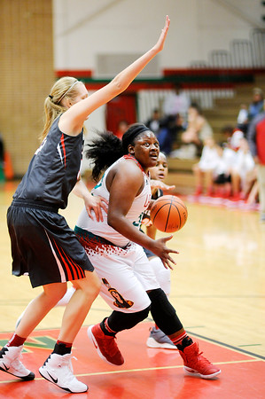 Don Knight | The Herald Bulletin<br /> Anderson's Kenigia Hamilton drives into the paint against Fishers' Audrey Turner on Wednesday.