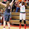 Don Knight | The Herald Bulletin<br /> Anderson's Staisha Hamilton shoots as she is guarded by Fishers Amanda Surber on Wednesday.
