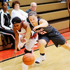 Don Knight | The Herald Bulletin<br /> Anderson's Antaria Hammond and Fishers' Alexandra Bankovich scramble for a loose ball on Wednesday.