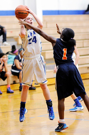 Don Knight | The Herald Bulletin<br /> APA's Savannah Prewett shoots as she is guarded by Indiana Math and Science Academy's Alisha Walker on Thursday.