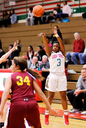 Don Knight |  The Herald Bulletin<br /> Anderson's Staisha Hamilton shoots a three-point basket as the Tribe hosted McCutcheon on Friday.
