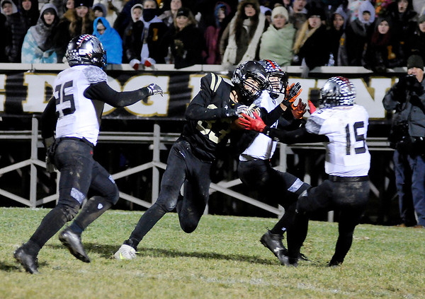 Don Knight | The Herald Bulletin<br /> Lapel's Dane Busch pulls in a 35 yard touchdown pass from Cole Alexander at the end of the first half as the Bulldogs hosted the Eastbrook Panthers in the regional on Friday.