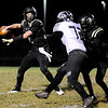 Don Knight | The Herald Bulletin<br /> Lapel quarterback Cole Alexander passes as Gavin Manis blocks Eastbrook's Joshua Rogers in the regional on Friday.
