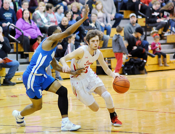 Don Knight |  The Herald Bulletin<br /> Liberty Christian hosted Indianapolis Metropolitan on Saturday.