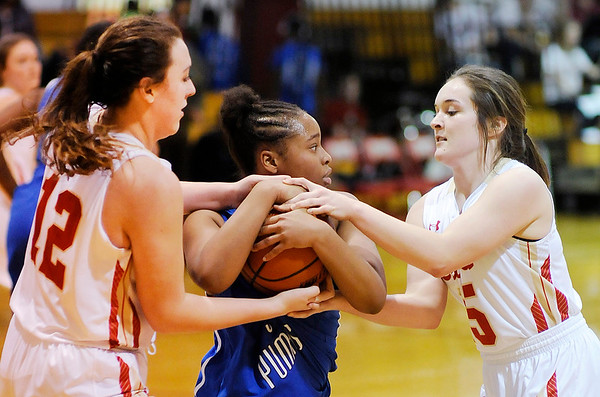 Don Knight |  The Herald Bulletin<br /> Liberty Christian's Sarah Aikin, left, and Kennedy Fillmore force a jump ball while guarding Indianapolis Metropolitan's Zoey Lewis on Saturday.