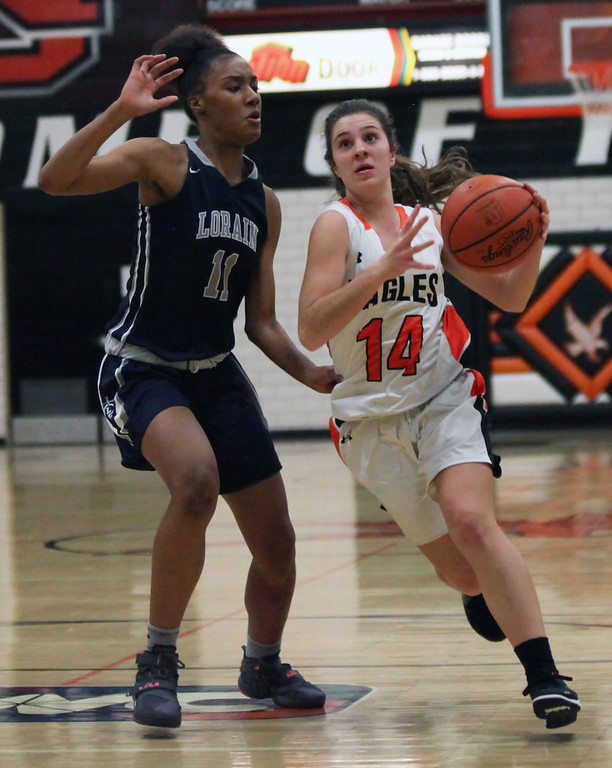 . Randy Meyers - The Morning Journal North Olmsted\'s Alexandra Diamantis drives the lane against Malaya Simmons of Lorain during  the first quarter on Dec. 5.