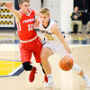 Don Knight | The Herald Bulletin<br /> Shenandoah's Braydin Myers drives as he is guarded by Frankton's Landon Weins as the Raiders hosted the Eagles on Saturday.