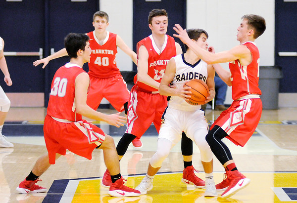 Don Knight | The Herald Bulletin<br /> Frankton's Kayden Key, Keegan Freestone and Landon Weins trap Shenandoah's Chase Kinsey at midcourt as the Raiders hosted the Eagles on Saturday.