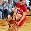 John P. Cleary |  The Herald Bulletin<br /> Alexandria's Madison Schuyler fights for the ball with Frankton's Destyne Knight.