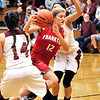 John P. Cleary |  The Herald Bulletin<br /> Frankton's Sydney Tucker splits the Alexandria defense as she drives the lane for a layup.
