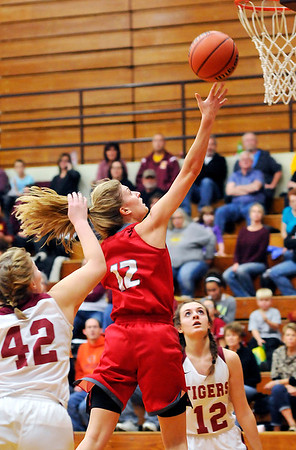 John P. Cleary |  The Herald Bulletin<br /> Frankton's Sydney Tucker lays the ball in the basket for two of her 40 points.