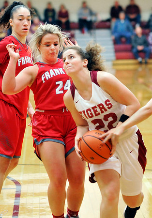 John P. Cleary |  The Herald Bulletin<br /> Alexandria's Blaine Kelly gets a step on Frankton's Aleyah Rastetter as she drives to the basket.