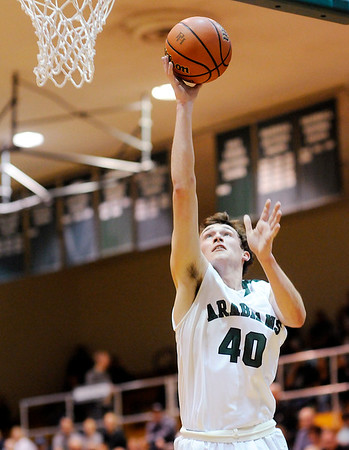 Don Knight | The Herald Bulletin<br /> Pendleton Heights Brandon Helpling lays up a basket as the Arabians hosted Northeastern on Saturday.