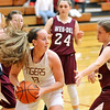 John P. Cleary |  The Herald Bulletin<br /> Alexandria's Mackenzie McCarty looks to pass after grabbing a rebound.
