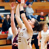 John P. Cleary |  The Herald Bulletin<br /> Alexandria's Blaine Kelly lets go with the ball after driving to the basket.