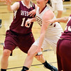 John P. Cleary |  The Herald Bulletin<br /> Alexandria's Kirsten VanHorn drives the lane against Wes-Del's Alexis Clock.