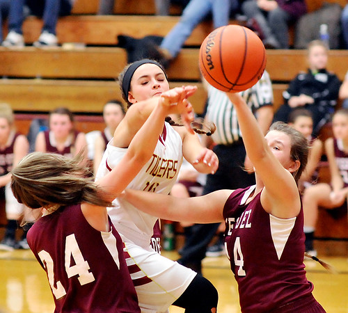 John P. Cleary |  The Herald Bulletin<br /> Alexandria's Allison Aiman drives between two Wes-Del defenders as she makes a pass.