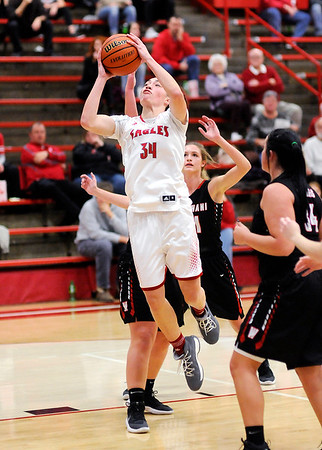 Don Knight |  The Herald Bulletin<br /> Frankton's Destyne Knight drives into the lane as the Eagles hosted the Wapahani Raiders on Tuesday.