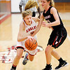 Don Knight |  The Herald Bulletin<br /> Frankton's Sydney Tucker draws a foul from Wapahani's Sydney Cook on Tuesday.