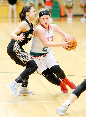 Don Knight | The Herald Bulletin<br /> Anderson's Katie Martin drives for a layup against Noblesville's Sam Salmon at the Teepee on Tuesday.