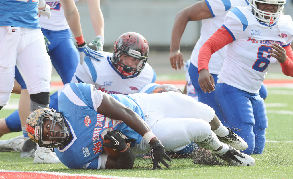 . News-Herald file Blue Team\'s Marcus Jones of Riverside High School, falls just short of a touchdown during the first quarter of the 2015 News-Herald Senior Bowl, June 19, at Jerome T. Osborne Stadium.