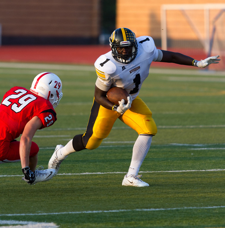 . News-Herald file Riverside running back Marcus Jones, tries to avoid Perry defender Brock Hurd in 2013.
