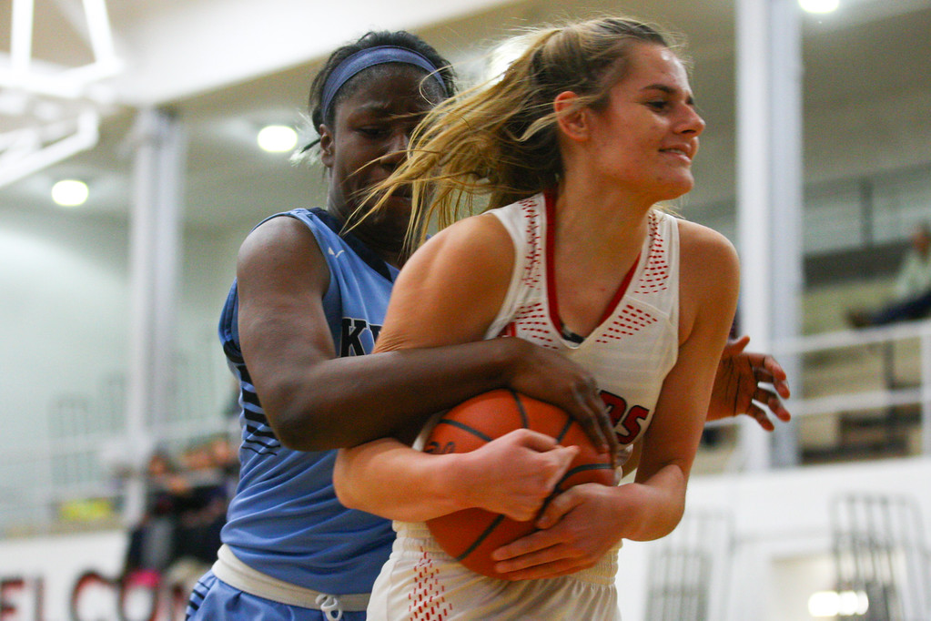 . David Turben - The News-Herald 2017 - Basketball - Kenston at Chardon.  Kenston defeated Chardon 62-53.  Chardon\'s Sam Liechty (3) fights for control of a rebound with Kenston\'s Rayonna Peterson (34).