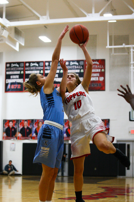 . David Turben - The News-Herald 2017 - Basketball - Kenston at Chardon.  Kenston defeated Chardon 62-53.  Chardon\'s Lindsey Nichols (10) goes up for a shot over Kenston\'s Marcie Oblesbee (3).