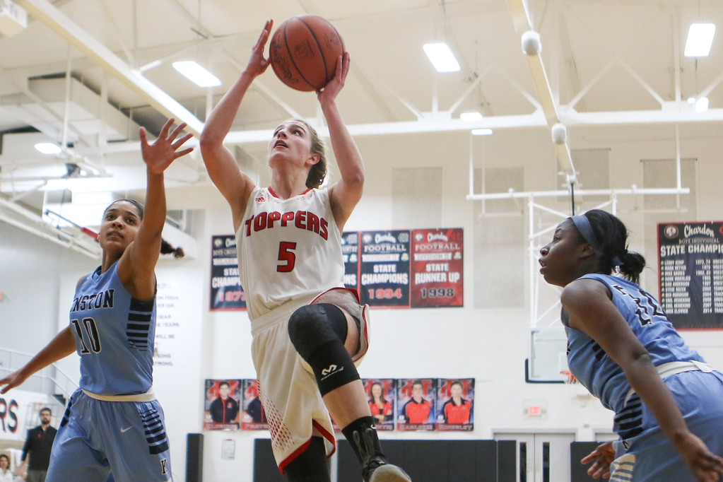 . David Turben - The News-Herald 2017 - Basketball - Kenston at Chardon.  Kenston defeated Chardon 62-53.  Chardon\'s Hallie Landies (5) goes in for a layup past Kenston defnders Corenna Maynard (10) and Rayonna Peterson (34).