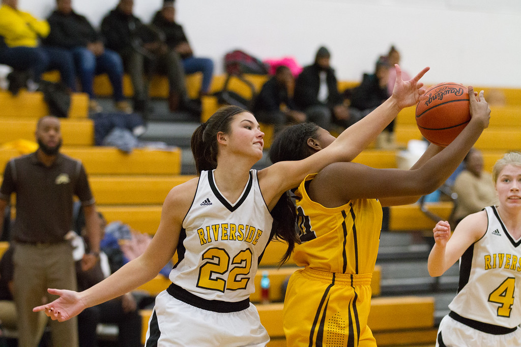 . Barry Booher - The News-Herald Brush\'s Taliah Jeter pulls a rebound away from Amy Kokal.