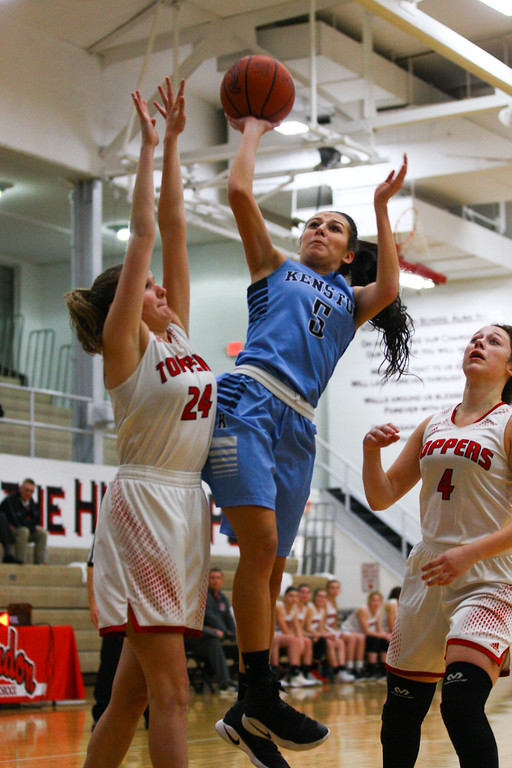 . David Turben - The News-Herald 2017 - Basketball - Kenston at Chardon.  Kenston defeated Chardon 62-53.  Kenston\'s Julie Hajdu (5) goes in for a layup past Chardon\'s defenders Faith DiLillo (24) and Grace Bradley (4).
