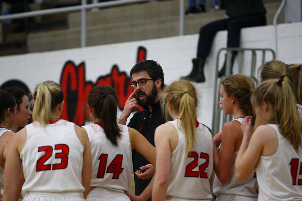 . David Turben - The News-Herald 2017 - Basketball - Kenston at Chardon.  Kenston defeated Chardon 62-53.  Chardon head coach Cullen Harris talks to his team during a time-out.
