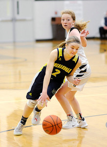 Don Knight | The Herald Bulletin Shenandoah's Kathryn Perry dribbles past Daleville's Ashlyn Craig on Thursday.