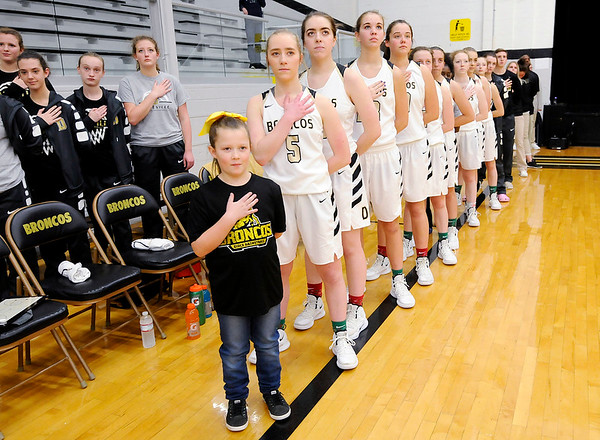 Don Knight | The Herald Bulletin<br /> The Daleville Broncos stand for the National Anthem before their contest against Shenandoah on Thursday.