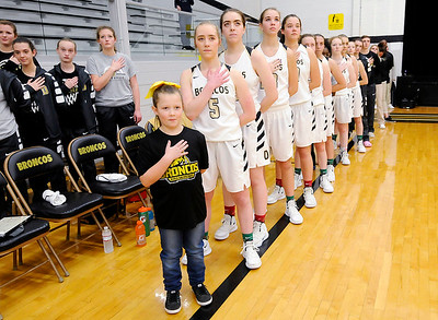 Don Knight | The Herald Bulletin The Daleville Broncos stand for the National Anthem before their contest against Shenandoah on Thursday.
