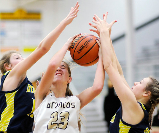Don Knight   The Herald Bulletin<br /> Daleville's Heather Pautler grabs a rebound between Shenandoah's Stormie Fitch, left, and Jenna Stewart on Thursday.