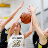 Don Knight | The Herald Bulletin<br /> Daleville's Heather Pautler grabs a rebound between Shenandoah's Stormie Fitch, left, and Jenna Stewart on Thursday.