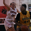 Faith DiLillo of Chardon (24) defends Brush's Taelor Lester (44) during a game against Brush at Chardon High School on December 14, 2016.